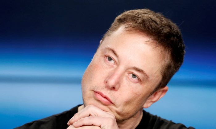 Elon Musk listens at a press conference following the first launch of a SpaceX Falcon Heavy rocket at the Kennedy Space Center in Cape Canaveral, Florida, U.S., February 6, 2018. REUTERS/Joe Skipper/File Photo