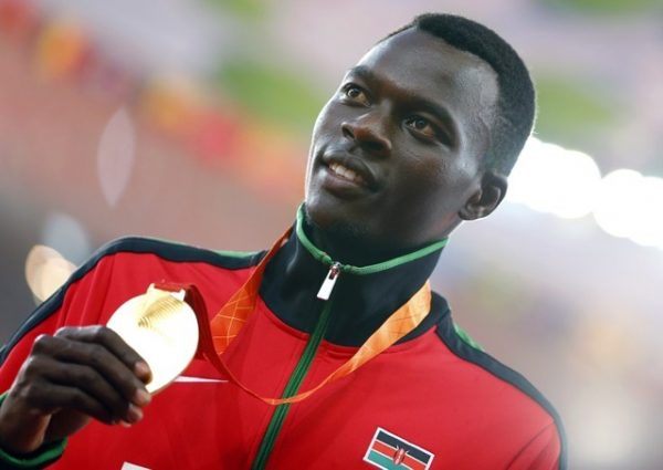 Nicholas Bett of Kenya presents his gold medal on the podium after the men's 400 meters hurdles event during the 15th IAAF World Championships at the National Stadium in Beijing, China, Aug. 26, 2015.