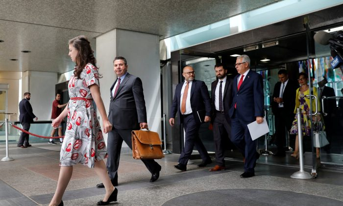 Turkish Deputy Foreign Minister Sedat Onal (2nd L) leaves after a meeting with U.S. Deputy Secretary of State John Sullivan at State Department in Washington, Aug. 8, 2018. (Reuters/Yuri Gripas)