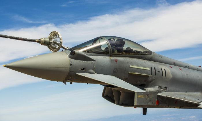A Spanish Air Force Eurofighter Typhoon accidentally fired a missile while conducting drills in Estonia on Aug. 7, 2018. Pictured: A Eurofighter Typhoon with the Spanish Air Force refuels from a KC-130J Hercules on Aug. 13, 2015, in Spain. (Staff Sgt. Vitaliy Rusavskiy/Marine Corps)