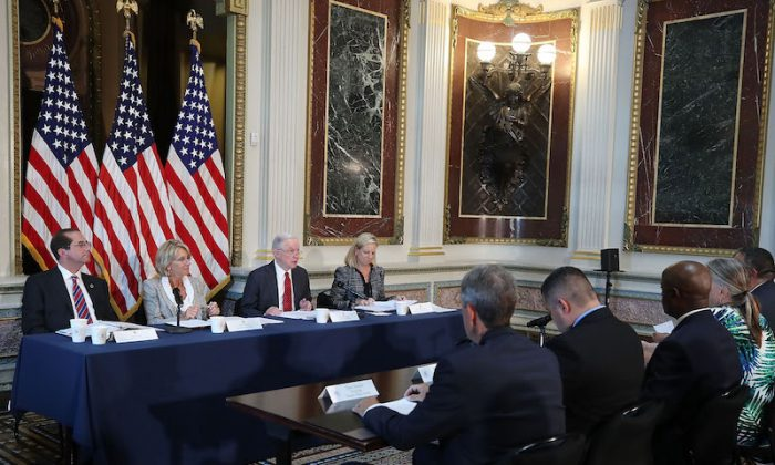 (L-R), HHS Secretary Alex Azar, Education Secretary Betsy DeVos, Attorney General Jeff Sessions, and Homeland Security Secretary Kirstjen Nielsen participate in a panel discussion on improving school safety, In the Eisenhower Executive Office Building, on July 26, 2018 in Washington, DC.  (Photo by Mark Wilson/Getty Images)