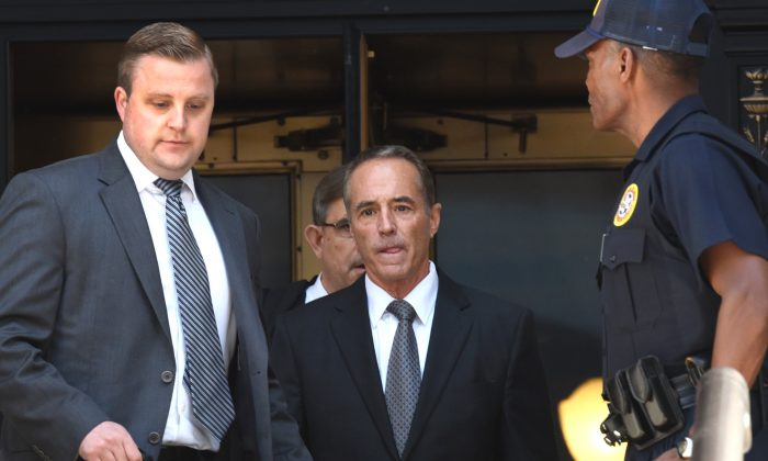 US Representative Chris Collins (C), a Republican from the of the 27th Congressional District of New York, leaves US Federal Court in New York on August 8, 2018 after being indicted on insider trading. (TIMOTHY A. CLARY/AFP/Getty Images)
