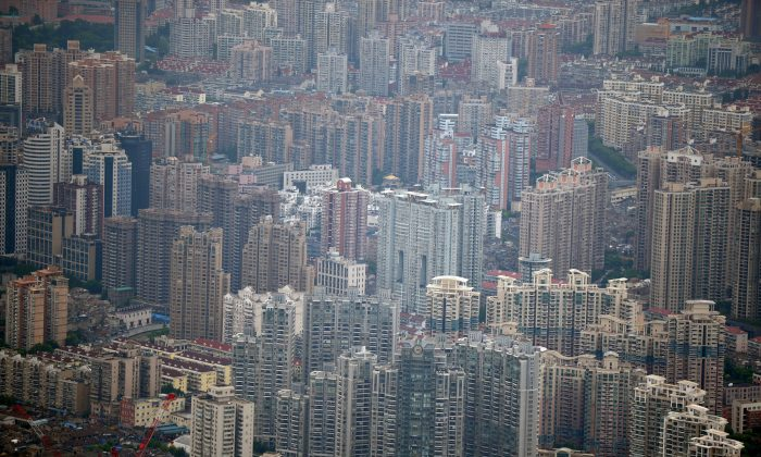 This photo taken on August 2, 2013 shows commercial and residential property from the under construction Shanghai Tower in Pudong, Shanghai. (PETER PARKS/AFP/Getty Images)