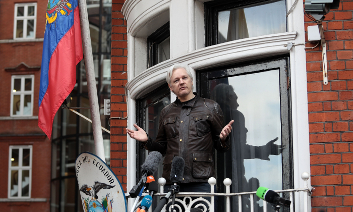 Julian Assange speaks to the media from the balcony of the Embassy of Ecuador on May 19, 2017 in London, England. (Jack Taylor/Getty Images)