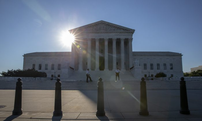 The sun rises over the United States Supreme Court on the morning of July 10, 2018 in Washington, DC. (Alex Edelman/Getty Images)