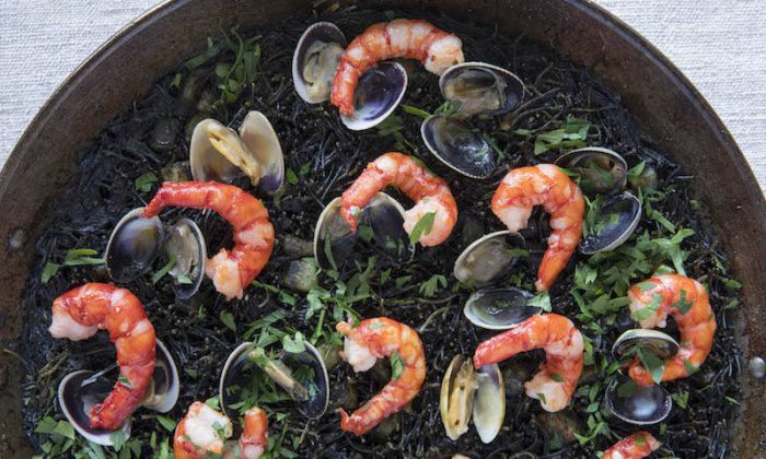 A big pan of paella; serve it with tapas, and it all makes for easy summer dinner party fare. (James Pomerantz)