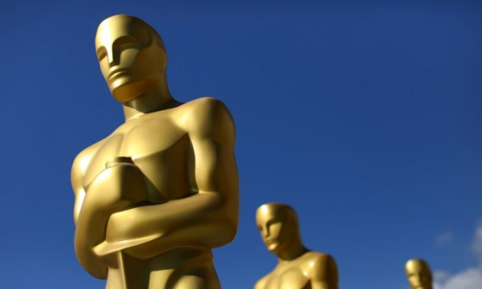 Oscar statues dry in the sunlight after receiving a fresh coat of gold paint as preparations begin for the 89th Academy Awards in Hollywood, Calif., on Feb. 22, 2017.   (Reuters/Mike Blake)