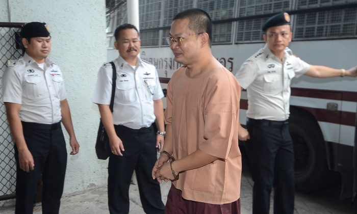 Wirapol Sukphol, former Thai Buddhist monk who provoked outrage with his lavish lifestyle arrives at the Criminal court in Bangkok, Thailand, Aug. 9, 2018. (Dailynews/via Reuters)