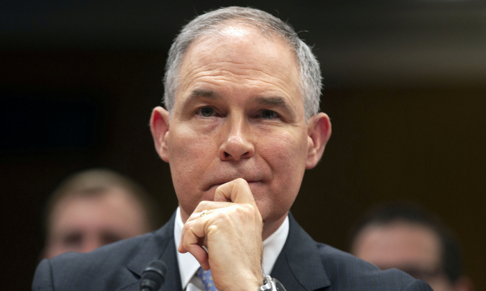 FILE PHOTO:    EPA Administrator Scott Pruitt testifies before a Senate Appropriations Interior, Environment, and Related Agencies Subcommittee hearing on the proposed budget estimates and justification for FY2019 for the Environmental Protection Agency on Capitol Hill in Washington, U.S., May 16, 2018. REUTERS/Al Drago/File Photo