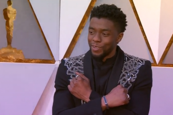 Chadwick Boseman poses during Oscars red carpet.