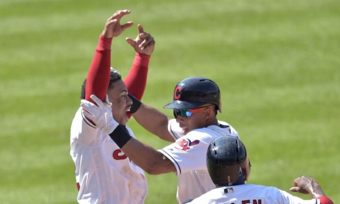 Aug. 9, 2018; Cleveland, Ohio; Cleveland Indians left fielder Michael Brantley, celebrates his game-winning hit against the Minnesota Twins with shortstop Francisco Lindor, and Greg Allen. (David Richard—USA TODAY Sports)