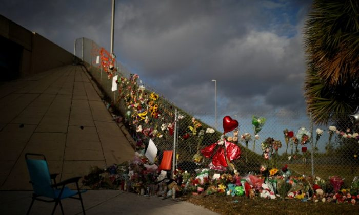 File photo: An empty chair is seen in front of flowers and mementoes placed on a fence to commemorate the victims of the mass shooting at Marjory Stoneman Douglas High School, in Parkland, Florida, U.S., February 20, 2018. (Reuters/Carlos Garcia Rawlins)