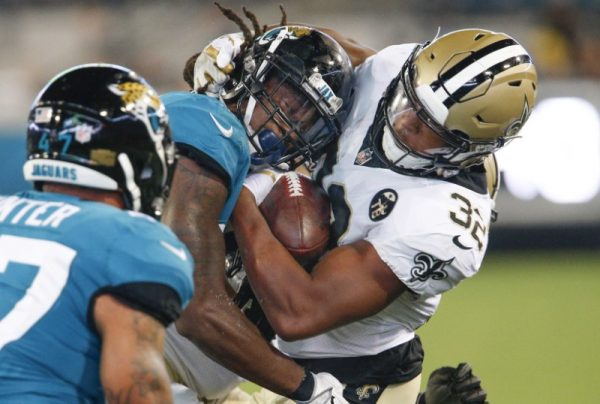 New Orleans Saints running back Jonathan Williams is hit by Jacksonville Jaguars defensive back Jarrod Wilson after a catch during the second half.