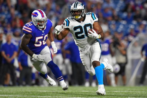 Carolina Panthers running back C.J. Anderson runs with the ball in front of Buffalo Bills linebacker Ramon Humber.