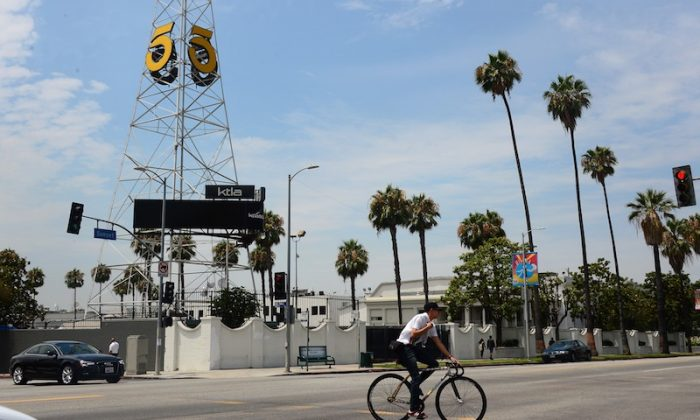 A cyclist rides on Sunset Boulevard past the KTLA channel 5 tower in Hollywood, California on July 10, 2013. (FREDERIC J. BROWN/AFP/Getty Images)