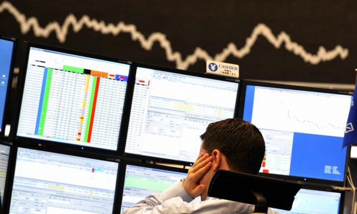 File Photo: A broker looks at his screens at Frankfurt's stock exchange on September 15, 2008, in the wake of US investment banking giant Lehman Brothers filing for bankruptcy amid the global financial crisis.(Thomas Lohnes/AFP/Getty Images)