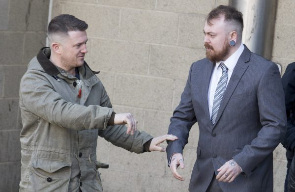 Mark Meechan (right) and Tommy Robinson speak to the media at Airdrie Sheriff Court at Meechan's trial on March 20, 2018. (SWNS)