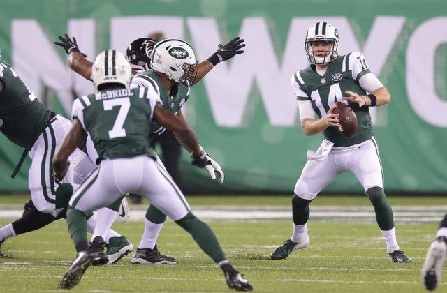 New York Jets quarterback Sam Darnold looks to pass as wide receiver Tre McBride runs a route during the first half against the Atlanta Falcons. (Vincent Carchietta—USA Today Sports)