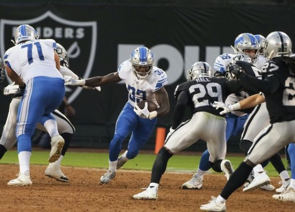 Detroit Lions running back Kerryon Johnson carries the ball against the Oakland Raiders during the first quarter.