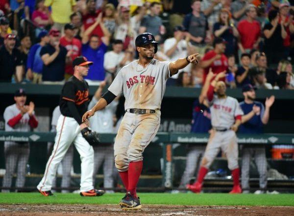Boston Red Sox shortstop Xander Bogaerts reacts after scoring a run in the sixth inning against the Baltimore Orioles.