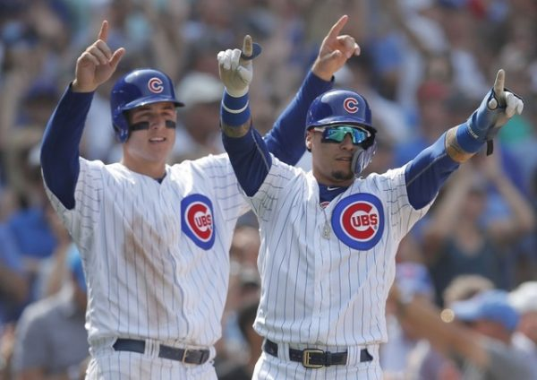 Chicago Cubs first baseman Anthony Rizzo, and Chicago Cubs second baseman Javier Baez celebrate after scoring two runs against the Washington Nationals during the sixth inning.