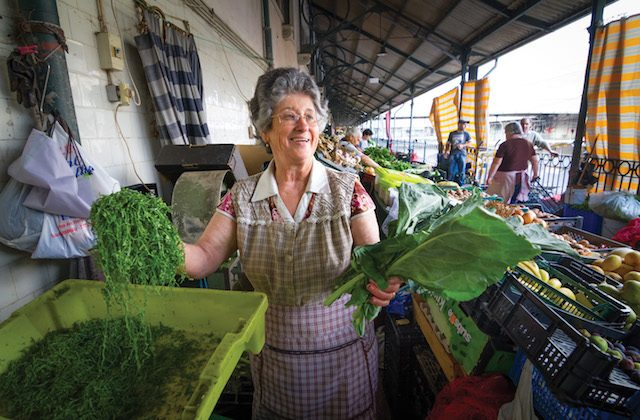 One of the eldest vendors at the market, Albina da Silva remembers hauling hundreds of crates of produce onto the train from Gondomar to Bolhão. (Ryan Opaz)