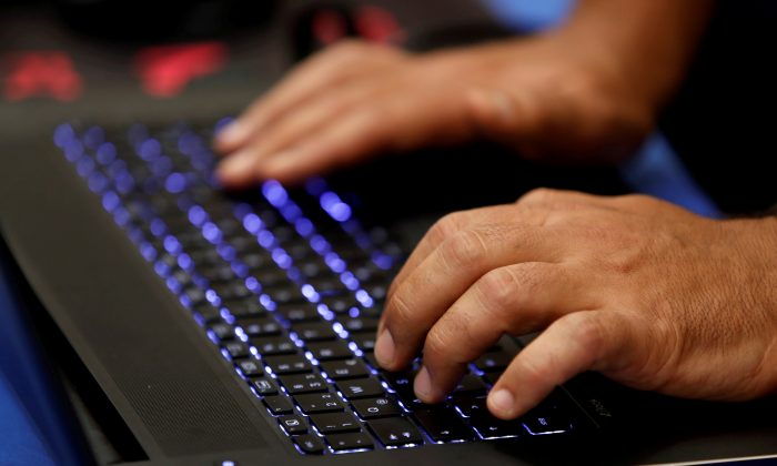 A man types into a keyboard during the Def Con hacker convention in Las Vegas, Nevada, on July 29, 2017. (REUTERS/Steve Marcus/File Photo)