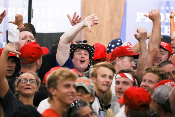 Audience members boo the media at a Make America Great Again rally in Lewis Center, Ohio, on Aug. 4, 2018. (Charlotte Cuthbertson/The Epoch Times)
