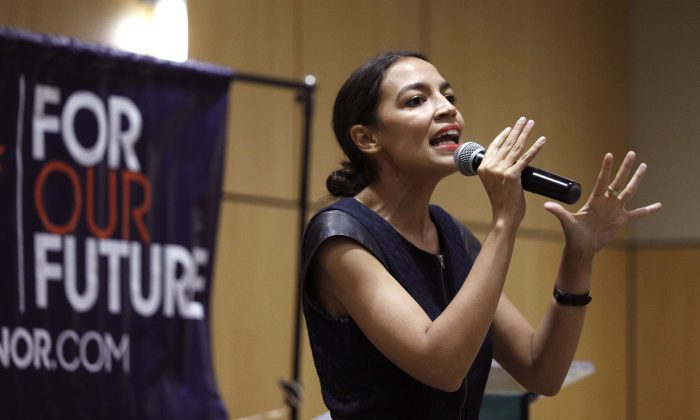 New York Democrat candidate for Congress Alexandria Ocasio-Cortez campaigns for Michigan Democratic gubernatorial candidate Abdul El-Sayed at a rally on the campus of Wayne State University in Detroit, Michigan, on July 28, 2018. (Bill Pugliano/Getty Images)
