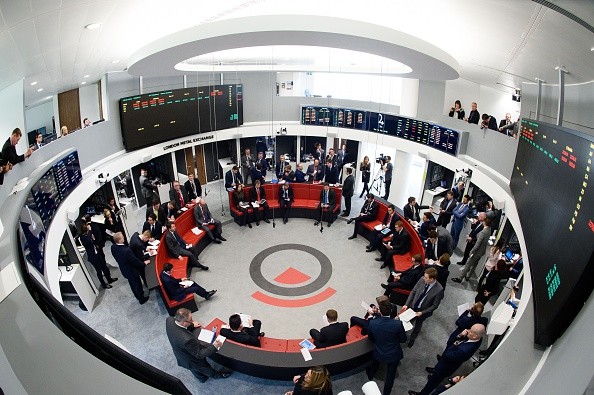 Traders operate in the Ring, the open trading floor of the new London Metal Exchange (LME) in central London on Feb. 18, 2016. (Photo credit should read LEON NEAL/AFP/Getty Images)