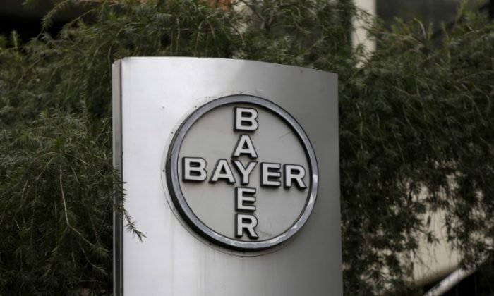 The corporate logo of Bayer is seen at the headquarters building in Caracas, Venezuela March 1, 2016. (REUTERS/Marco Bello)