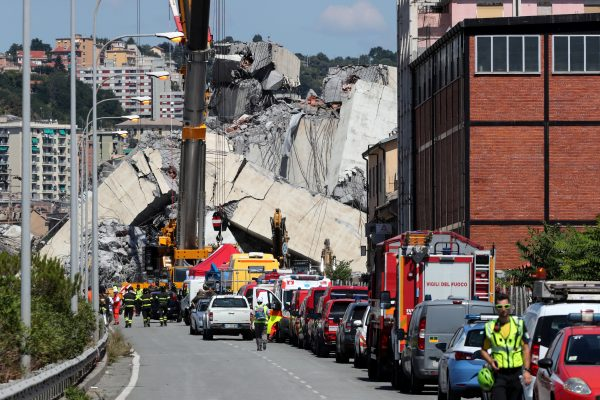 Rescue crews at the site of the Morandi bridge disaster