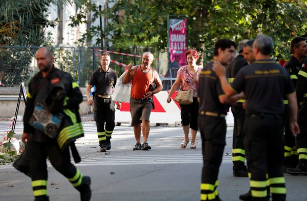 Residents evacuating their homes are escorted by firefighters