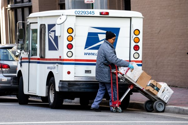 A woman unloads a USPS truck in Norfolk, Va., on Jan. 26, 2018. (Samira Bouaou/The Epoch Times)