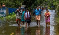 India Races to Avert Disease Outbreak as Flood Waters Recede