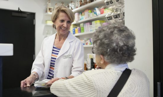 A pharmacist at the Northside Pharmacy in Brooklyn, New York, on June 18, 2014. (Samira Bouaou/Epoch Times)