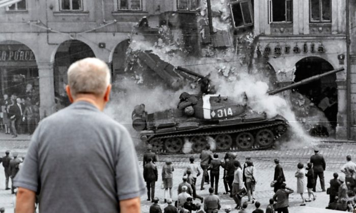 A man looks at a picture, commemorating the 50th anniversary of the Soviet-led invasion into former Czechoslovakia, placed on a street in Liberec, Czech Republic, Aug. 21, 2018. (Reuters/David W Cerny)