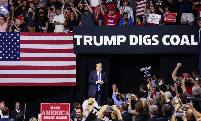 President Donald Trump comes onstage at a Make America Great Again rally in Charleston, W. Va., on Aug. 21, 2018. (Charlotte Cuthbertson/The Epoch Times)