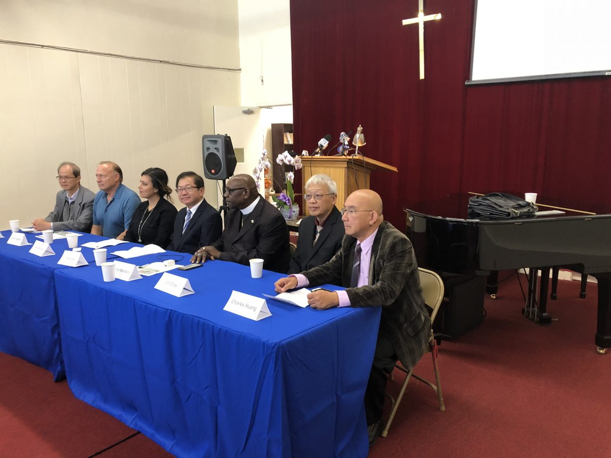 Wayne Lo, Scott Chipman, Faye Maloney, Frank Lee, Bishop Allen, Jim Chow, Charles Huang attend a press conference opposing the opening of a facility for injecting illegal drugs in San Franciso. (Nathan Su/Epoch Times)