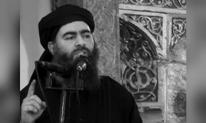 A video posted on a militant website July 5, 2014, purports to show the leader of ISIS, Abu Bakr al-Baghdadi, delivering a sermon at a mosque in Iraq during his first public appearance. (Militant video/AP/ File)