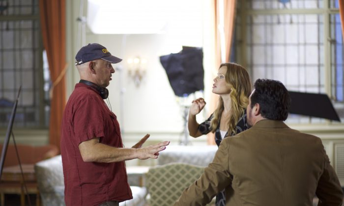 "Director Nick Searcy with Sarah Jane Morris and Dean Cain, on the set of the film ""Gosnell."" (Courtesy of Hat Tip Films)"