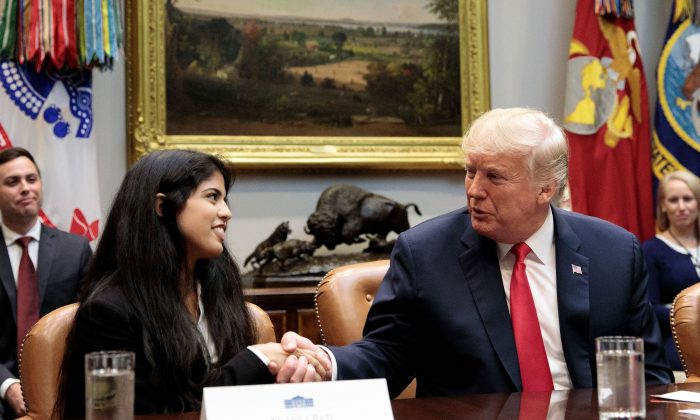 President Donald Trump shakes hands with Ananya Pati of the Community Anti-Drug Coalitions of America during an announcement on grants for the Drug-Free Communities Support Program in the Roosevelt Room of the White House in Washington on Aug. 29, 2018. (Samira Bouaou/The Epoch Times)