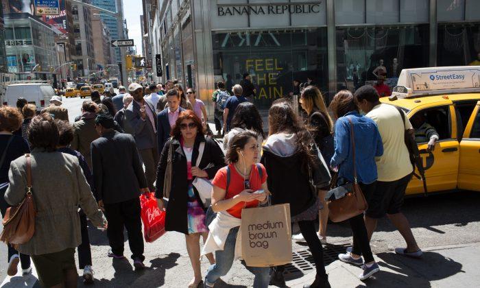Shoppers walk along Lexington Avenue in Midtown Manhattan on April 29, 2015. Kevin Hagen/Getty Images