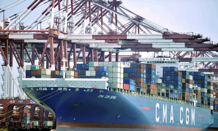 A container ship is docked at a port in Qingdao in eastern China's Shandong Province on July 6. The higher cost of Chinese imports and a depreciating currency mean inflation is rising. (Chinatopix via AP)