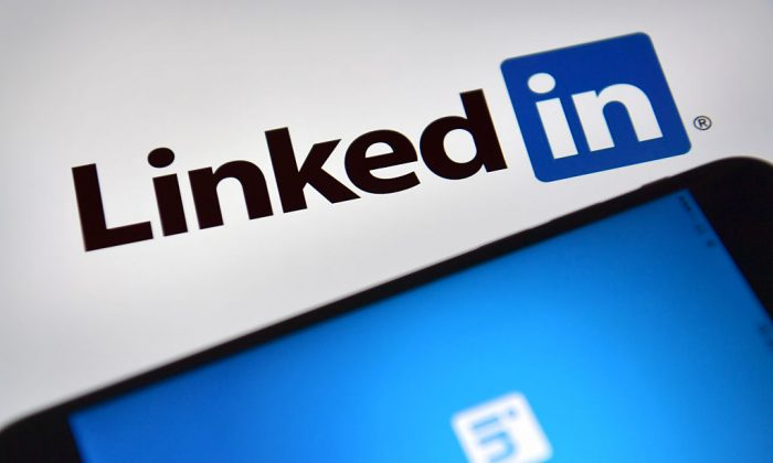 LinkedIn logos are displayed on an iPhone and computer screen in London, England, on Aug. 3, 2016. (Carl Court/Getty Images)