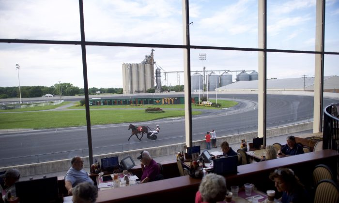 Bettors dine as horses warm up before races at Harrington Raceway and Casino in Harrington, Delaware on June 5, 2018. (Mark Makela/Getty Images)
