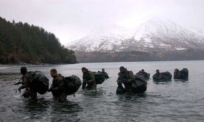 Navy SEALs perform Advanced Cold Weather training to experience the physical stress of the environment and how their equipment will operate, or even sound, in adverse conditions Dec. 14, 2003 in Kodiak, Alaska. (Photographer's Mate 2nd Class Eric S. Logsdon/U.S. Navy via Getty Images)