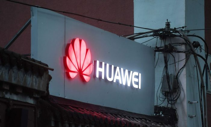 A Huawei sign outside a store selling mobile phones in Beijing on Aug. 6, 2018. (Greg Baker/AFP/Getty Images)