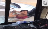 Woman Who Attacked Bus and Driver Held Without Bond