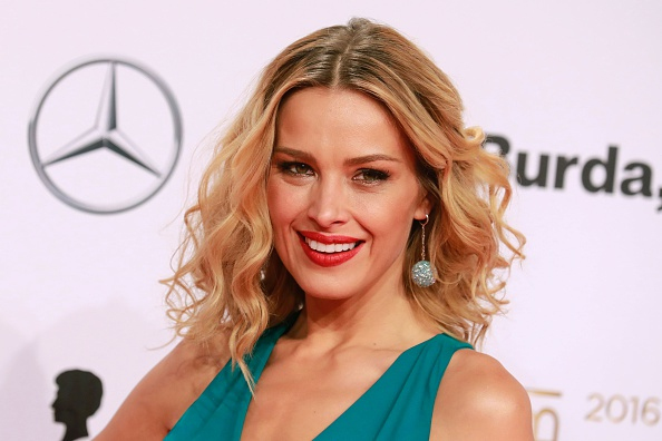 Czech model Petra Nemcova poses for photographers as she arrives for the Bambi awards on Nov. 17, 2016 in Berlin.  (AXEL SCHMIDT/AFP/Getty Images)